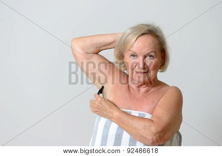 Middle Aged Blond Woman Shaving Her Armpit