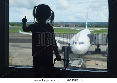 Little Child Waiting For Boarding To Flight In Airport Terminal