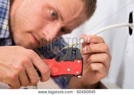 Close-up Of Electrician Stripping Wires