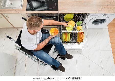 Disabled Man In Kitchen