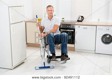Handicapped Man Mopping Floor