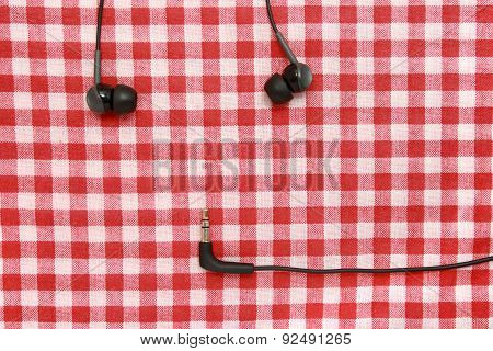 Headphones On A red tablecloth.