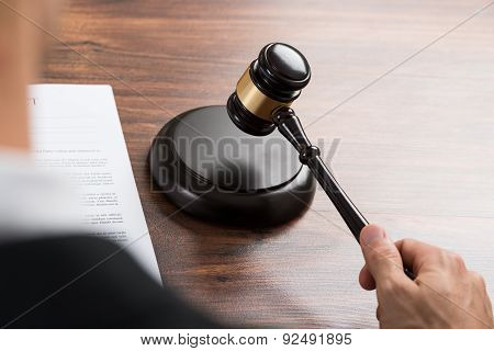 Judge Hitting The Gavel At Desk