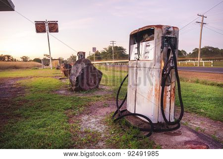 Old rustic pump at an abandoned fuel station