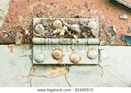 Hinge And Rust And Rivet On Old Light Green Metal Sheet Horizontal