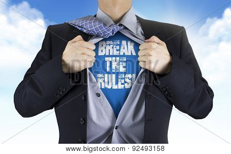 Businessman Showing Break The Rules Words Underneath His Shirt