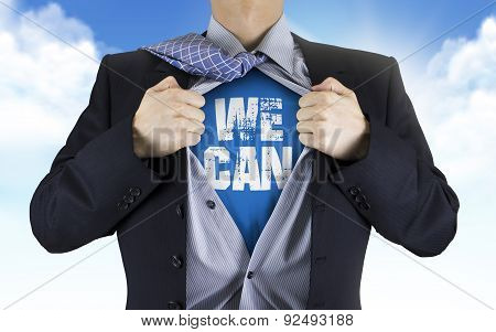 Businessman Showing We Can Words Underneath His Shirt