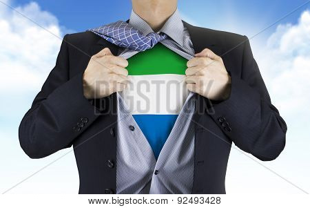 Businessman Showing Sierra Leone Flag Underneath His Shirt