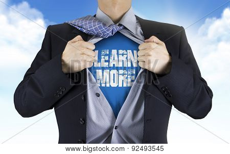 Businessman Showing Learn More Words Underneath His Shirt