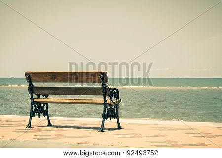 Blue Sea,long Wood Chairs At The Tropical Beach On Blue Sky.