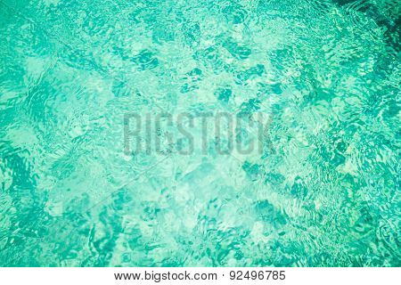 Rippling water in a pool. Bright green water background
