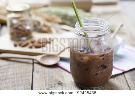 Cold Chocolate Milk Drink (close-up Shot) On Wooden Background