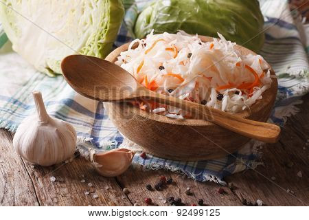 Sauerkraut In A Wooden Plate Closeup And Ingredients.