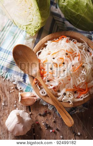 Sauerkraut And Carrots In A Wooden Plate Close Up Vertical Top View