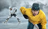foto of ice hockey goal  - Ice hockey player on the ice in mountains - JPG