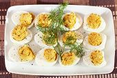 picture of yolk  - Stuffed eggs with mustard and yolk in a plate one portion - JPG