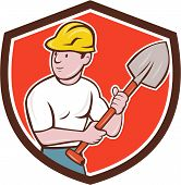 stock photo of spade  - Illustration of a builder construction worker wearing hardhat holding spade looking to the side set inside shield crest on isolated background done in cartoon style - JPG