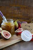 pic of jar jelly  - Fresh ripe Autumn fruit figs with fig jelly preserve in jar on cutting board against dark wood background - JPG