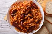 stock photo of stew  - stewed cabbage with sausages close - JPG