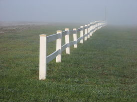 pic of white vinyl fence  - photograph of a vinyl fence taken in early morning hours - JPG