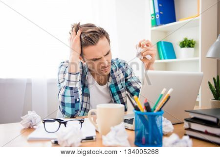 Portrait of depressed man in bad mood failing task
