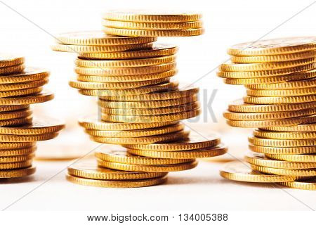 Coins stacked on each other in different positions. Money concept.