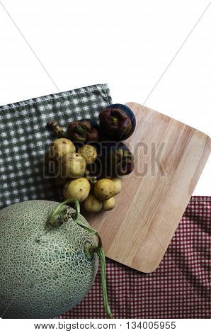 Lansium parasiticum mangosteen and melon with fabric background.