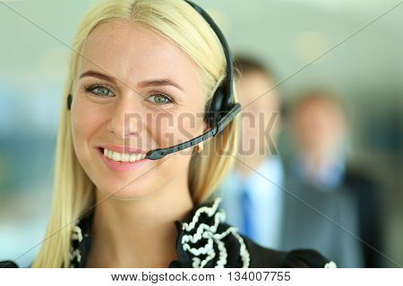 Portrait of support phone operator with the headset .