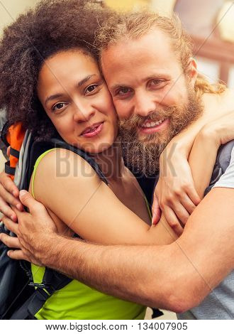 Closeup of beautiful couple of tourists in love enjoy their journey