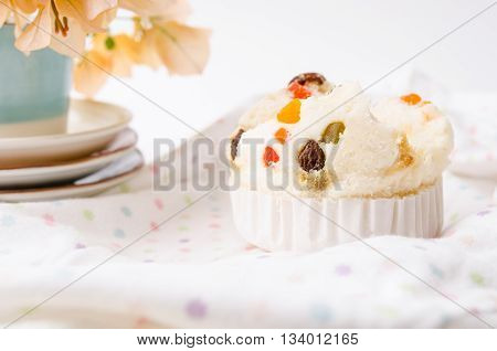 Thai dessert Thai steamed cup cake or cotton wool cake with fabric background