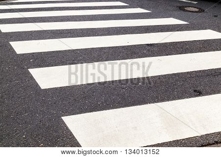 street with pedestrian crossing marked with white paint