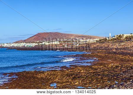 Beach And Village  Of Playa Blanca With The Volcano Montana Roja In The Background