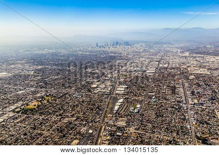 aerial of Los Angeles with dusty sky and view to skyscraper