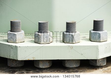big screw and bolt on the bottom of power tower