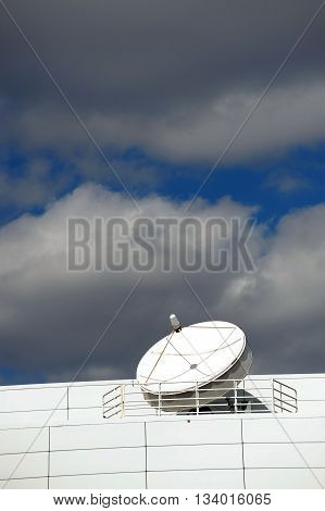 global communication antenna and cloud sky in vertical composition