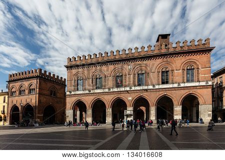 CREMONA ITALY - APRIL 26 2016: Town Hall is the former seat of the Ghibelline power in the city. Rebuilt in the Romanesque-Gothic style between 1206 and 1246 it was later extensively remodeled.