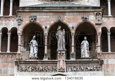 14th century statues on the upper loggia of Cremona Cathedral are portraying the Madonna with Child and two bishops