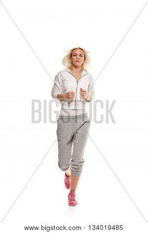 Running fit fitness sport model jogging isolated on white background. Caucasian fitness girl training.
