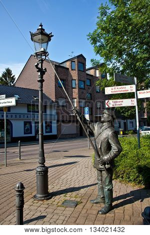 WILLICH, GERMANY - JUNE 3, 2014: statue for the historic figure of the lateerepit the man who lights up the laterns in the evening in former times
