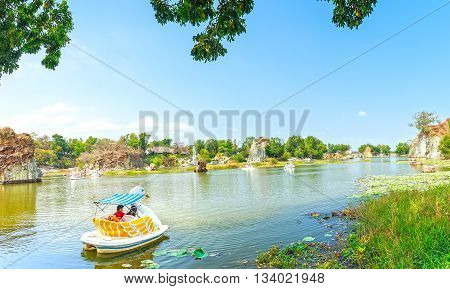 Dong Nai, Vietnam - February 23rd, 2015: The lovers relaxing on a swan boat on lake on sunny spring morning, distance floating boat trip on lake romantic air to welcome spring in Dong Nai, Vietnam