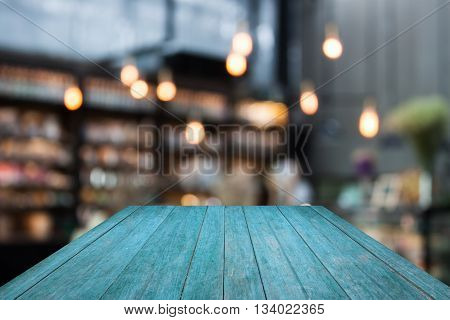 Perspective blue wooden on coffee shop blurred background with bokeh, stock photo