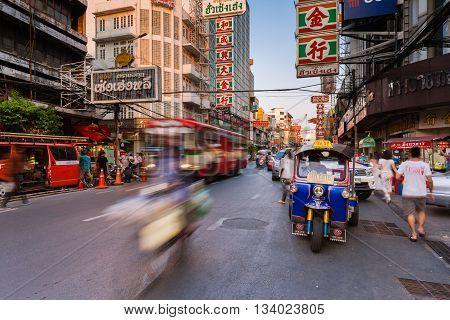 BANGKOK THAILAND - APRIL 24: Tuk-tuk taxi parked near street market in Chinatown on April 24 2016 in Bangkok Thailand.