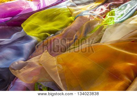 shawls in harmonic color mix at the market
