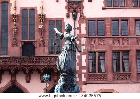 FRANKFURT, GERMANY - JUNE 17, 2012: Statue of Lady Justice in front of the Romer in Frankfurt - Germany