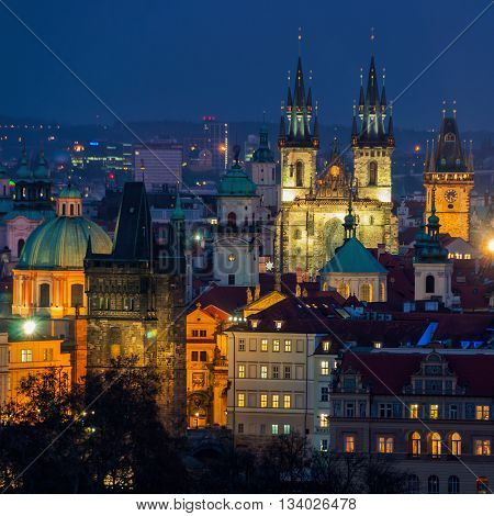 Aerial view of illuminated historical buildings of Prague, Czech Republic at Night. Charles bridge and Tyn Church.