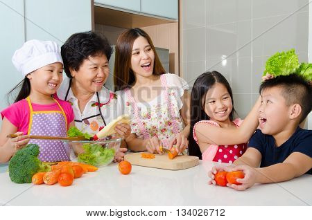 Asian family having fun in the kitchen