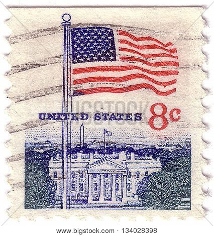 UNITED STATES - CIRCA 1968: A postage stamp printed in the United States features waving US flag circa 1968
