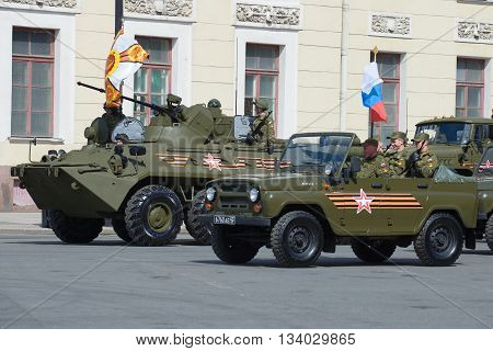 SAINT PETERSBURG, RUSSIA - MAY 05, 2015: Military UAZ-469 and BTR-82A before the rehearsal of parade in honor of Victory Day