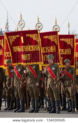 SAINT PETERSBURG, RUSSIA - MAY 05, 2015: The flags of the great Patriotic war in the ranks. Rehearsal of parade in honor of Victory Day