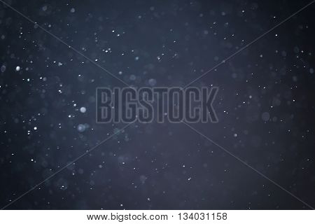 abstract blue particles background natural bokeh, real photo